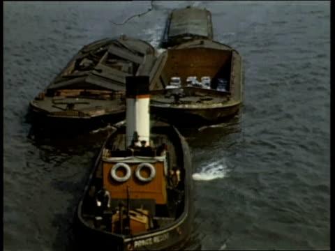 1940s MONTAGE barges delivering supplies on the river Thames / London United Kingdom
