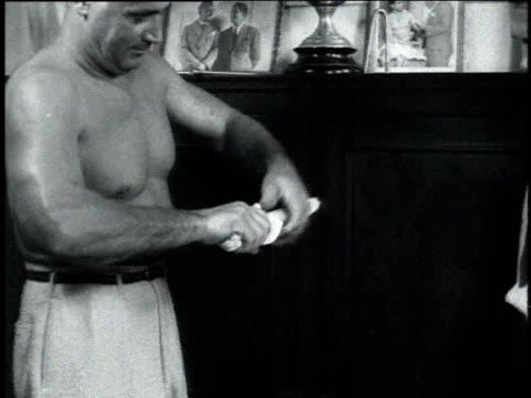 1940s montage bodybuilder charles atlas bending a lead pipe - charles atlas bildbanksvideor och videomaterial från bakom kulisserna