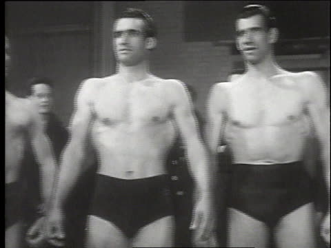 vídeos de stock e filmes b-roll de 1940s montage body-builders posing and flexing / canada - body building