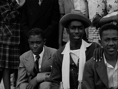 1940s MONTAGE B/W Group of African-American teenage boys and girls posing for camera/ Greenwood, Tulsa, Oklahoma, USA