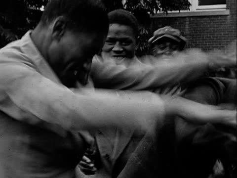 1940s MONTAGE B/W Group of teenage boys play fighting and messing about on front lawn/ Greenwood, Tulsa, Oklahoma, USA