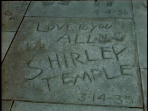 vídeos de stock e filmes b-roll de 1940s montage celebrity autographs in cement / hollywood, california, united states - shirley temple