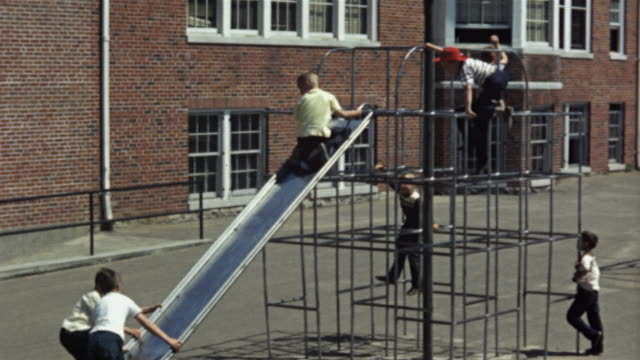 1940s ms montage children playing on slide and swings on school playground, columbia, missouri, usa - school yard stock videos & royalty-free footage
