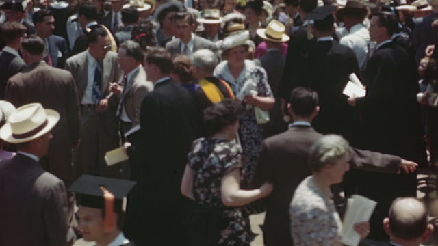 1940s MS HA MONTAGE Crowd of people at university campus after graduation, Columbia, Missouri, USA