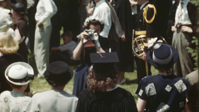 1940s ms cu ha montage crowd of people at university campus after graduation, columbia, missouri, usa - mortar board stock videos & royalty-free footage