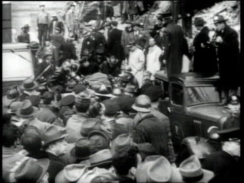 1940s montage crowd surrounding emergency scene / ha crowd surrounding man on stretcher / ms injured man being carried on stretcher / ms men helping... - medium group of objects stock videos & royalty-free footage