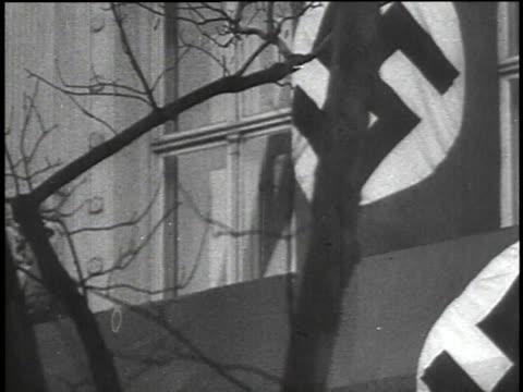stockvideo's en b-roll-footage met 1940s montage crowds chanting while hitler approaching podium / austria - hitler speech