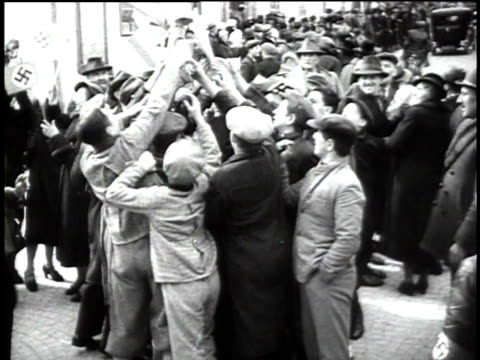 1940s montage crowds of people cheering for adolf hitler / austria - saluting stock videos & royalty-free footage