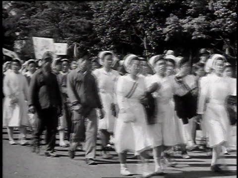 1940s MONTAGE Demonstrators marching / Japan