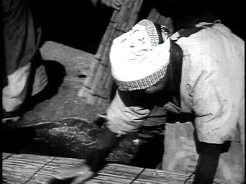 1940s Montage Farm Workers Making Handicrafts In Rural Japan Japan