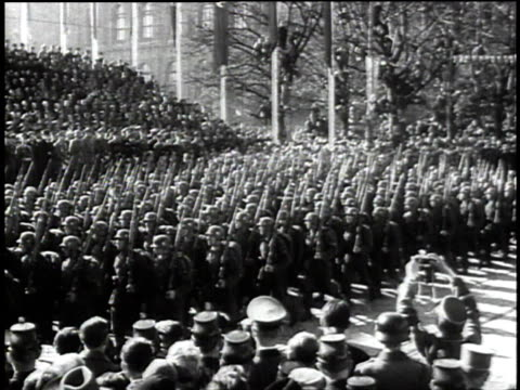 1940s montage goosestepping troops marching before cheering crowd / germany - third reich stock videos & royalty-free footage