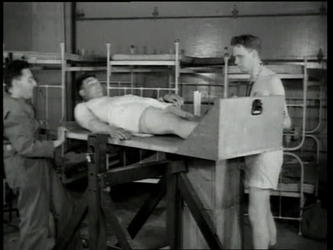 1940s montage heat exhaustion tests on soldiers including men walking on treadmills, taking vital signs and testing weight / fort knox, kentucky, united states - treadmill stock videos and b-roll footage