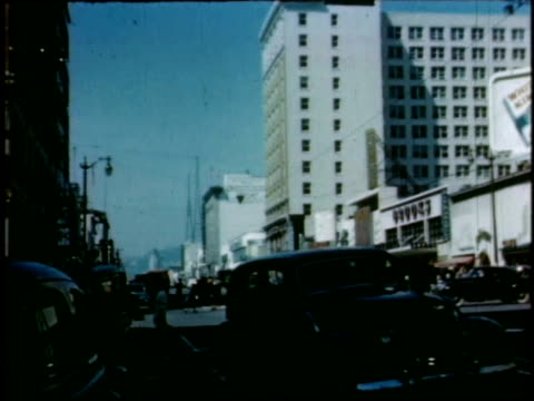 vídeos de stock e filmes b-roll de 1940s montage hollywood and vine / hollywood, california, united states - bulevar