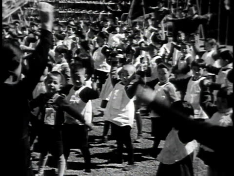 1940s montage japanese children in uniform exercising and marching / japan - military school stock videos and b-roll footage