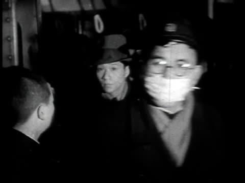 1940s montage japanese citizens disembarking from subway train, exiting subway station, and walking down street / japan - underground train stock videos & royalty-free footage