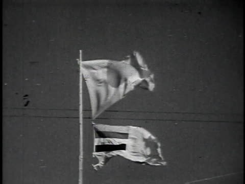 1940s montage japanese flag flying, and officials on platforms and horseback watching troops march past / japan - recreational horseback riding stock videos & royalty-free footage