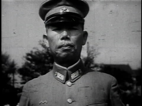 1940s MONTAGE Japanese soldiers marching and standing for inspection / Japan
