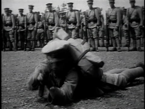 1940s MONTAGE Japanese soldiers performing training exercises and taking part in fencing match / Japan