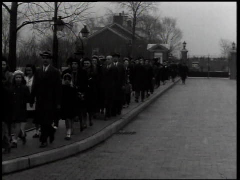 1940s montage lines of people in black walking down sidewalk / united states - mourning stock videos & royalty-free footage