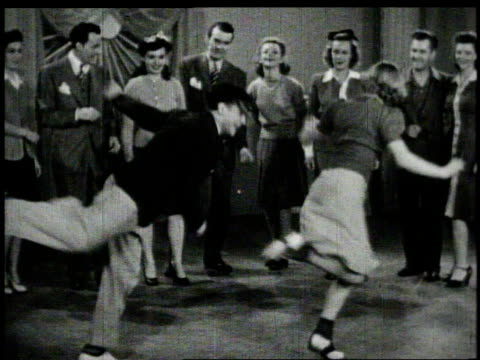 vidéos et rushes de 1940s montage man playing trumpet while dangers swing in the jitterbug - rock