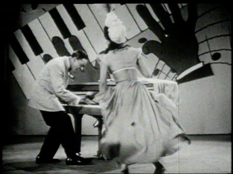1940s montage maurice rocco playing piano and singing  - singer stock videos & royalty-free footage