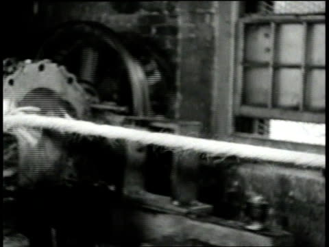 1940s MONTAGE Mechanized process for making rope / Boston, Massachusetts, United States