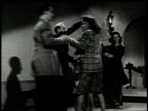 vidéos et rushes de 1940s montage men and women swing dancing  - rock face