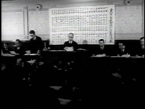 1940s montage men gathered for meeting inside the chamber of commerce and industry of japan / japan - 昭和天皇点の映像素材/bロール