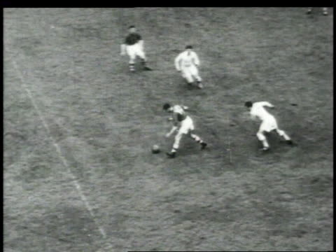1940s montage men playing rugby and fighting / united states - rugby sport stock videos & royalty-free footage