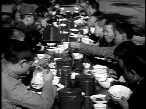 1940s montage military school students serving food and drink and eating at outdoor dining table / japan - showa period stock videos & royalty-free footage
