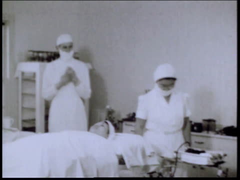 1940s montage operating room in camp hospital / crystal city texas united states - femmina con gruppo di maschi video stock e b–roll