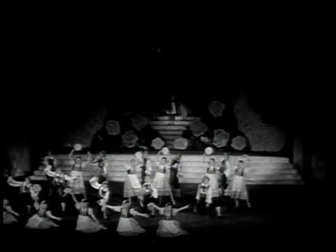 1940s MONTAGE Patrons attending theater production / Japan