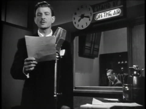 1940s montage radio announcer in studio reading from script and a man turning on radio to hear broadcast / united states - radio studio stock videos & royalty-free footage