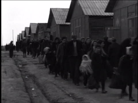 1940s montage refugees entering barracks / european theater of operations - rifugiato video stock e b–roll
