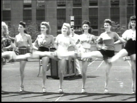 1940s montage rockettes rehearsing dance number on the roof of radio city music hall / new york city, new york, united states - radio city music hall stock videos & royalty-free footage