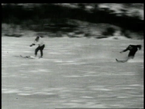 1940s MONTAGE Skiers being pulled across snow / United States
