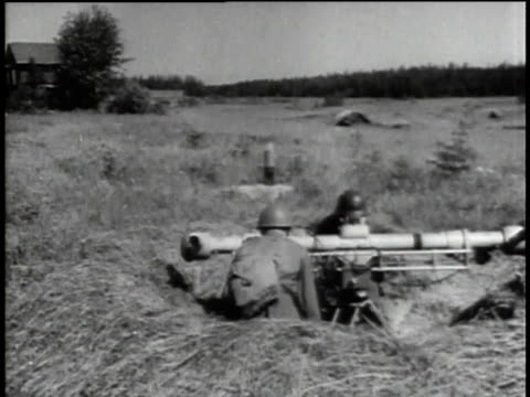 1940s montage soldiers in field aiming and loading artillery / russia - medium group of objects stock videos & royalty-free footage