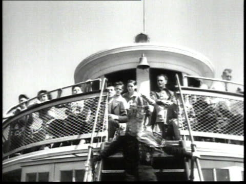 1940s montage tourists on sightseeing boat looking at statue of liberty / new york city, new york, united states - besichtigung stock-videos und b-roll-filmmaterial