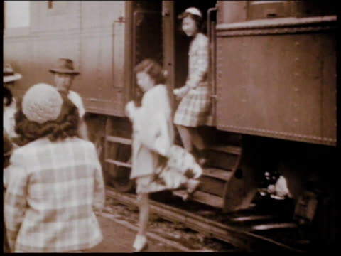 1940s montage wives and children of alien detainees emerging from train and taken to camp / crystal city, texas, united states - undocumented immigrant stock videos & royalty-free footage