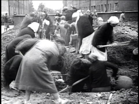 1940s montage women and men digging foundations for air raid shelters / russia - explosive stock videos & royalty-free footage
