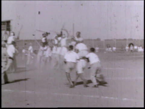 1940s montage young men jousting without horses at alien detention facility / crystal city texas united states - jousting stock videos and b-roll footage