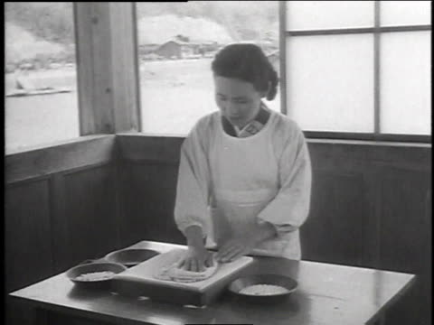 1940s MOTAGE woman sorting grading and polishing pearls / Japan