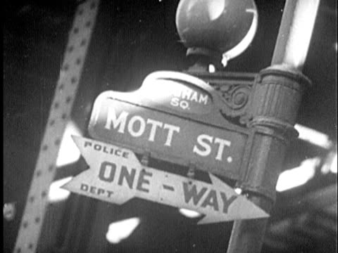 b/w cu 1940s 'mott street' sign at 'chatham square' and 'one-way' sign / new york city, new york - greenwich village stock videos & royalty-free footage