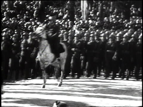 1940s ws mounted troops and marching troops passing reviewing stand / germany - pferdeartige stock-videos und b-roll-filmmaterial