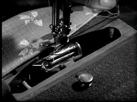 slo mo b/w montage 1940s needle and shuttle of sewing machine and woman approaching to antique car - sewing machine stock videos & royalty-free footage