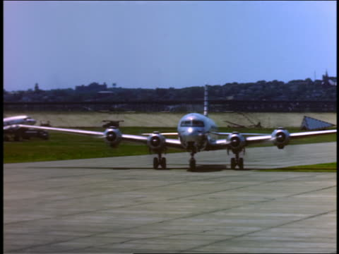 1940s or 50s pan braniff airways 4-propeller airplane taxiing past camera - propeller aeroplane stock videos & royalty-free footage