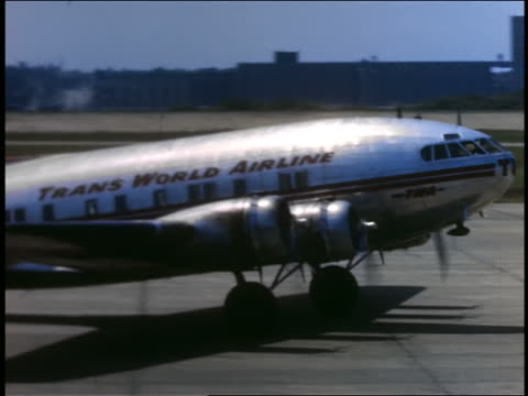 1940s or 50s pan twa 4-propeller airplane taxiing past camera - twa video stock e b–roll
