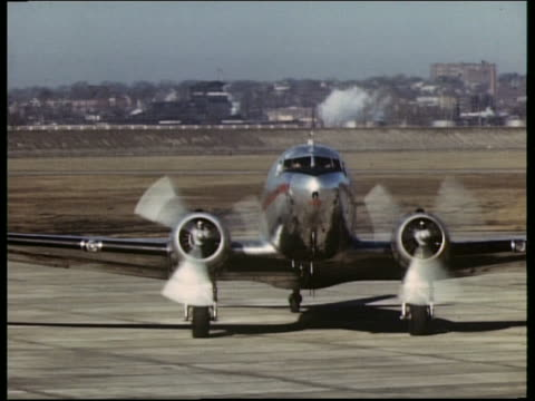 1940s or 50s twa propeller airplane taxiing towards camera - propeller stock videos & royalty-free footage