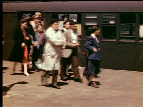 1940s people exiting subway train at outdoor coney island station / brooklyn, nyc - coney island brooklyn stock videos and b-roll footage