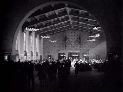 1940s ws people milling about inside train station - union station los angeles stock videos & royalty-free footage